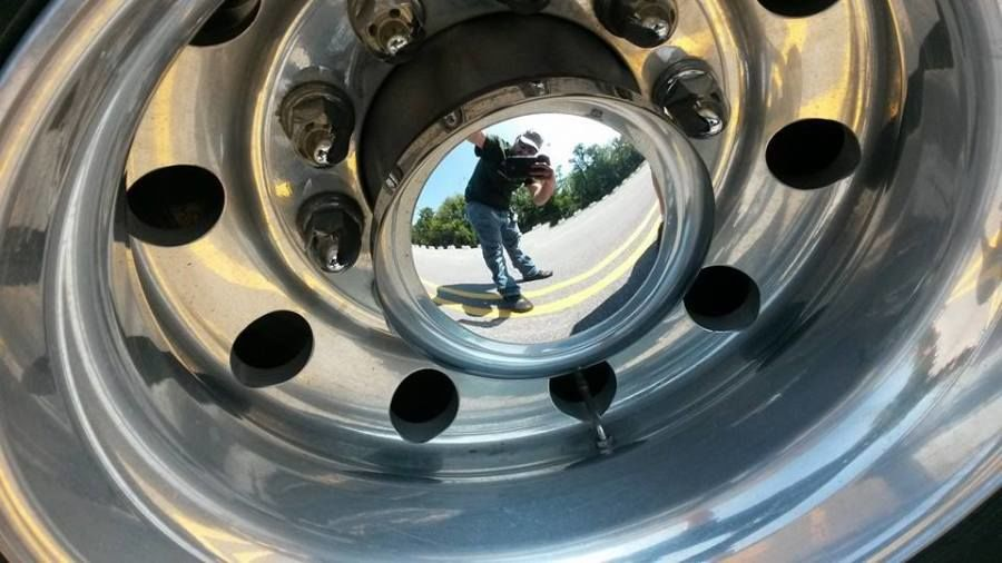 truck drivers picture in a reflective hubcap