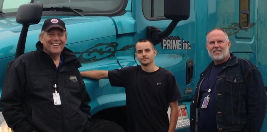 Prime truck drivers standing in front of Prime truck