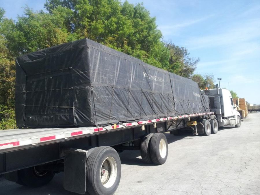 properly tarped and secured load on a flatbed trailer