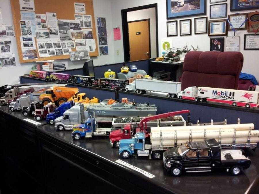 model trucks on desk at Swift truck driver training academy