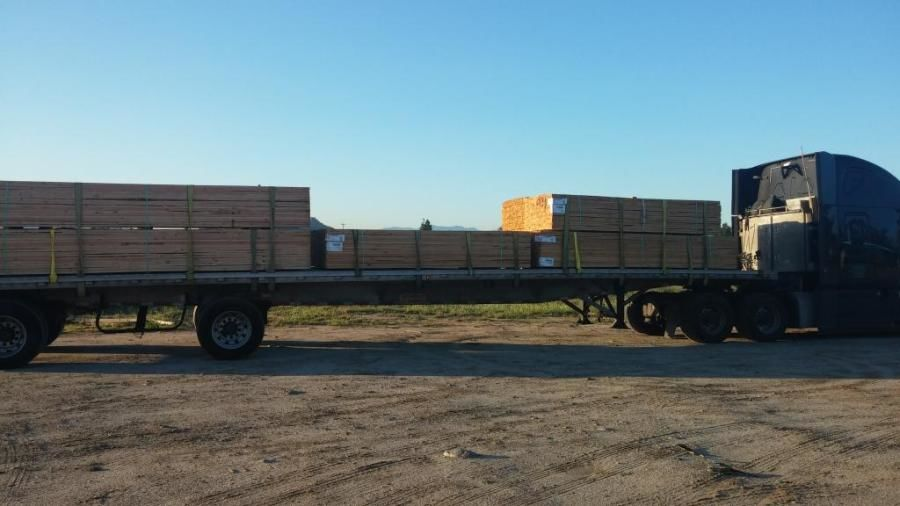 flatbed trailer loaded with lumber