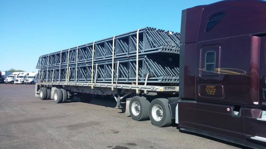 flatbed trailer loaded with steel trusses
