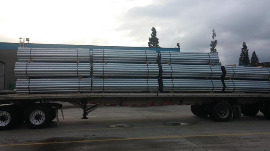 steel tubing loaded on flatbed trailer
