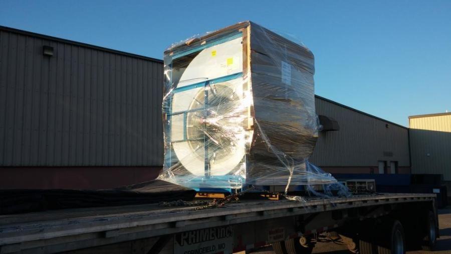 industrial fan loaded on flatbed trailer