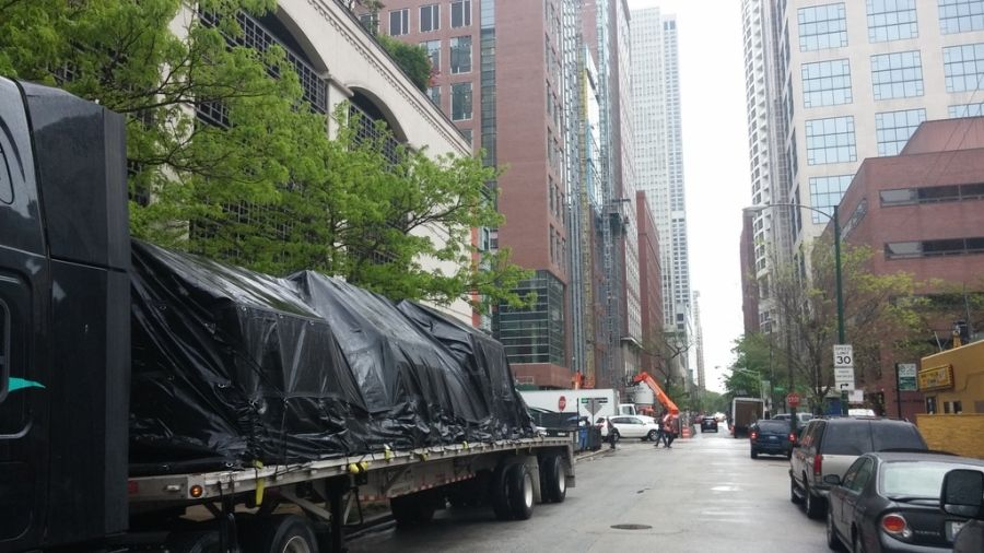 tarped and strapped load on a flatbed trailer in Chicago