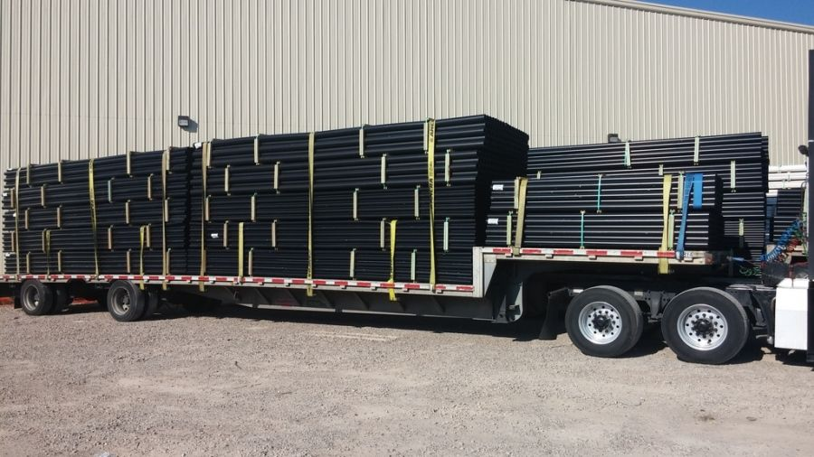stepdeck flatbed loaded with pipe