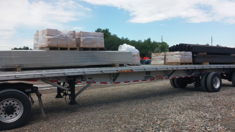 flatbed trailer loaded with guard rail parts in Salt Lake City