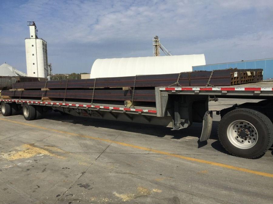 steel guardrail beams loaded on flatbed trailer in Charleston SC