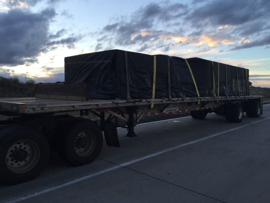 load of sheetrock strapped and tarped on flatbed trailer headed from Oklahoma to Utah