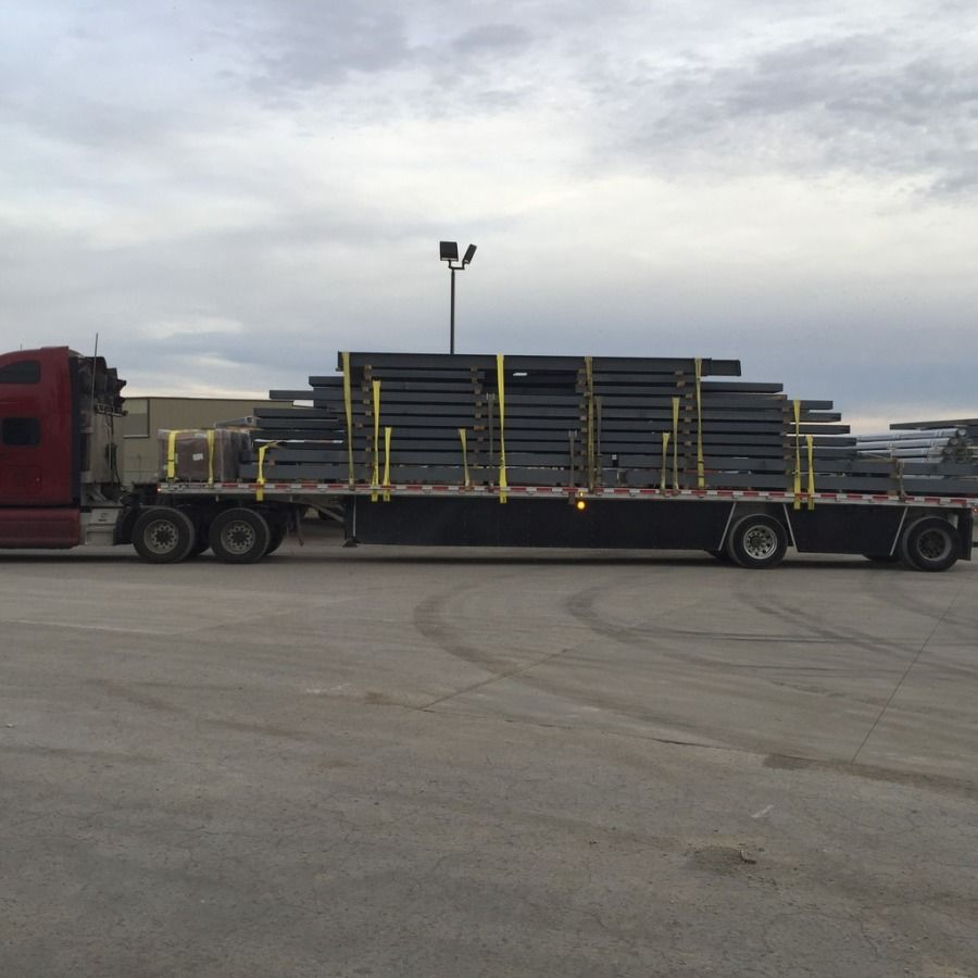 high stacked load of structural steel strapped on flatbed trailer going from Missouri to Ohio