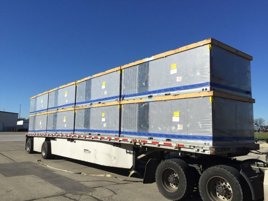 flatbed truck loaded high with air conditioning units in Texas