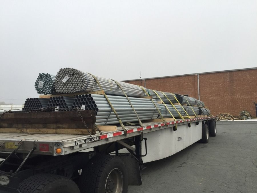 flatbed trailer loaded with small steel tubing and strapped in Chicago