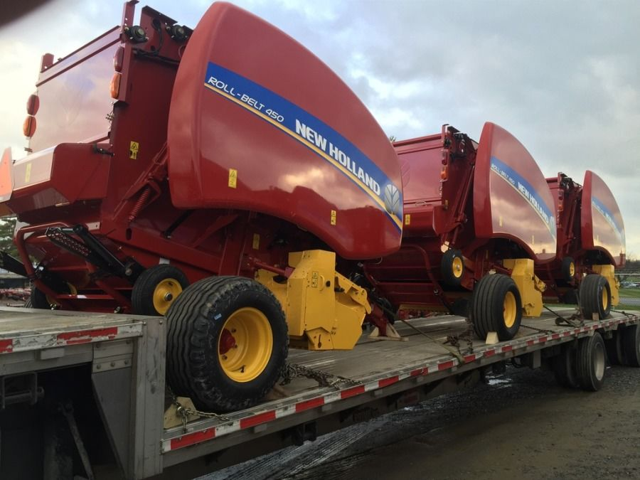 New Holland balers loaded on flatbed trailer