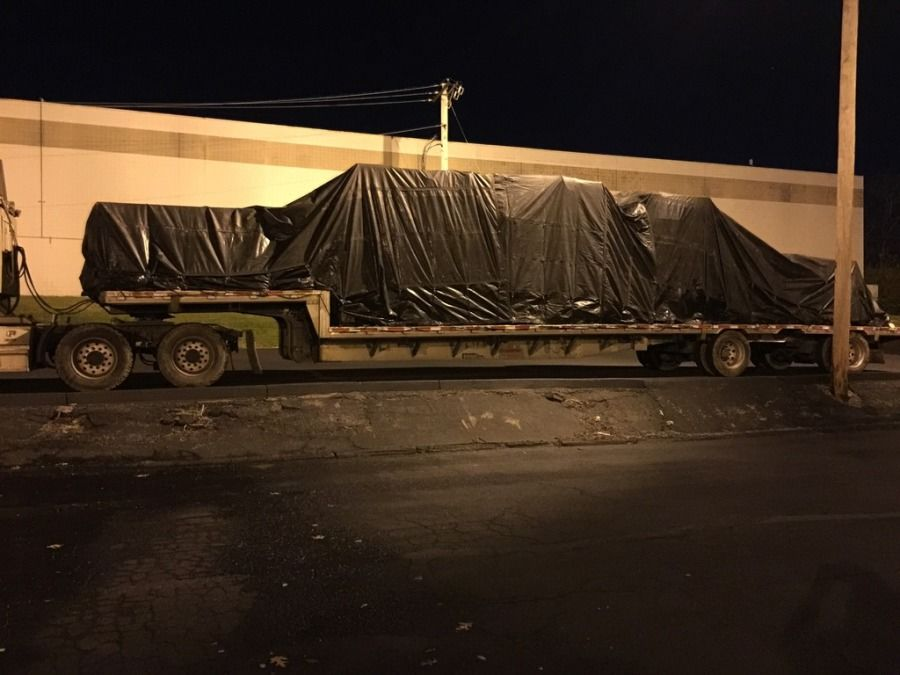 difficult to secure flatbed loaded strapped and chained and tarped at night