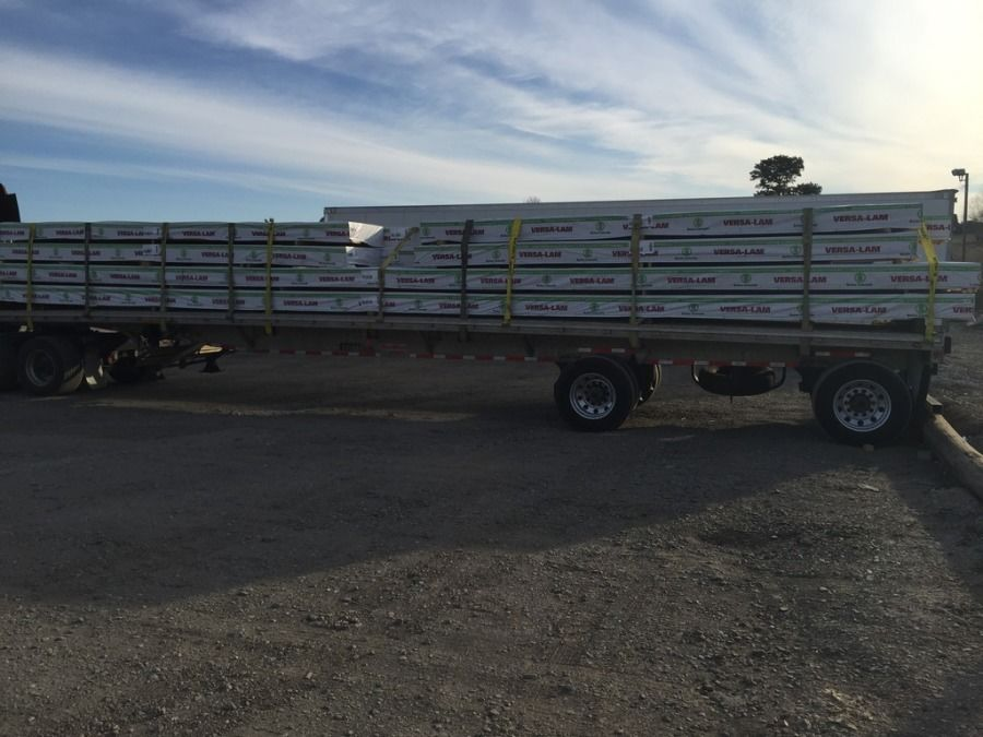 joists loaded and strapped on flatbed trailer