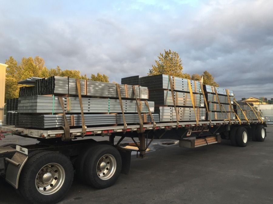 bundles of steel bars loaded and strapped on flatbed trailer