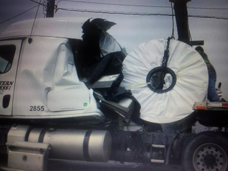 unsecured flatbed coil load crushes truck