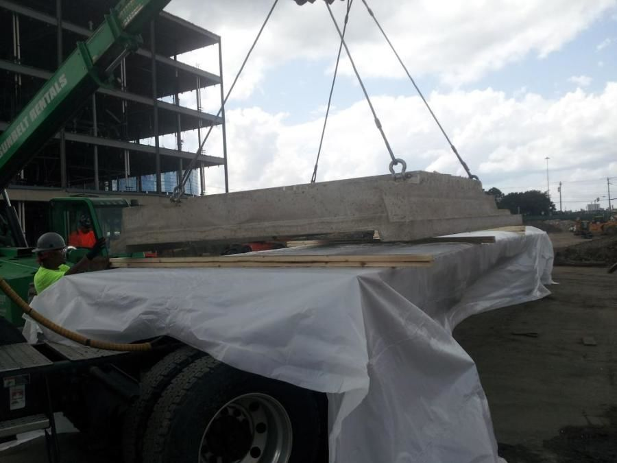 concrete panels with asbestos loaded on flatbed trailer