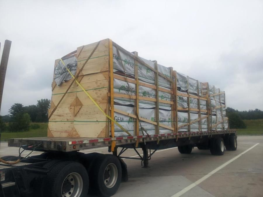 flatbed loaded with aluminum siding and strapped in Eau Claire Wisconsin