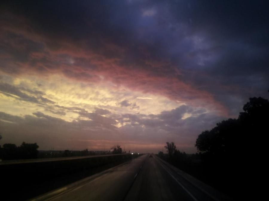 trucking photo of stormy sky and sun scenery
