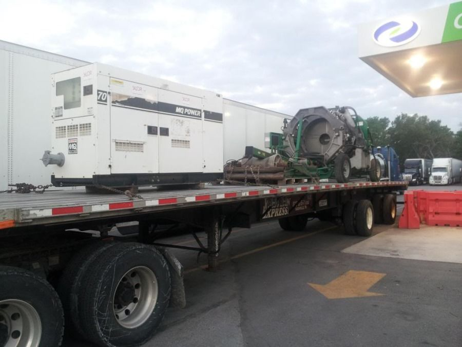 flatbed trailer loaded with a generator
