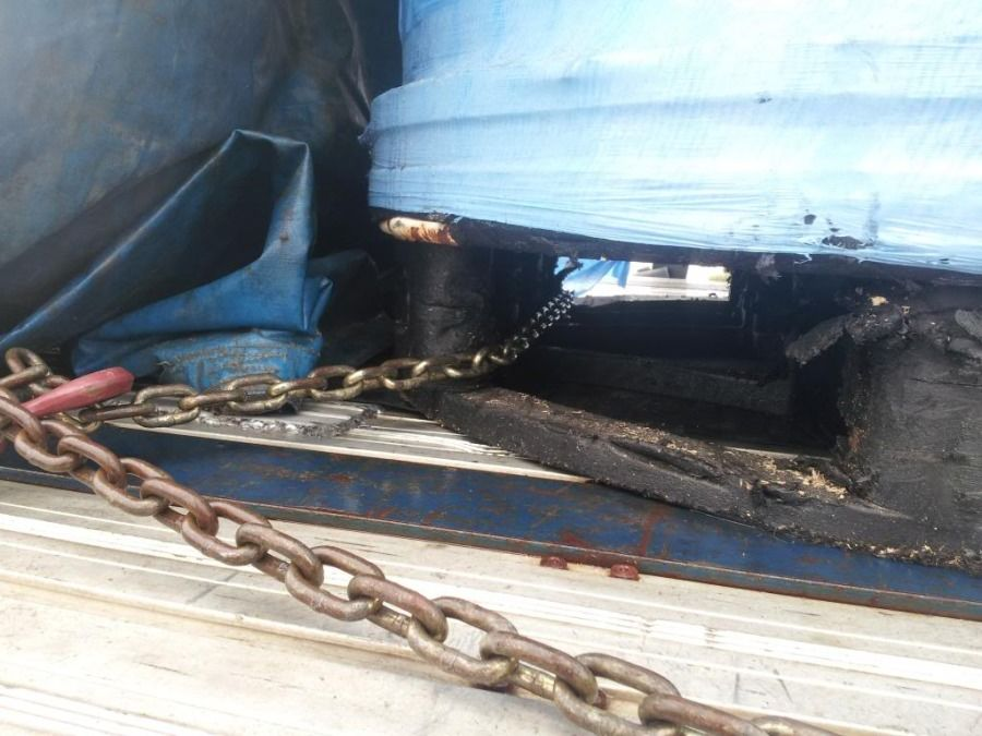 close-up example of pallets chained and secured on flatbed trailer