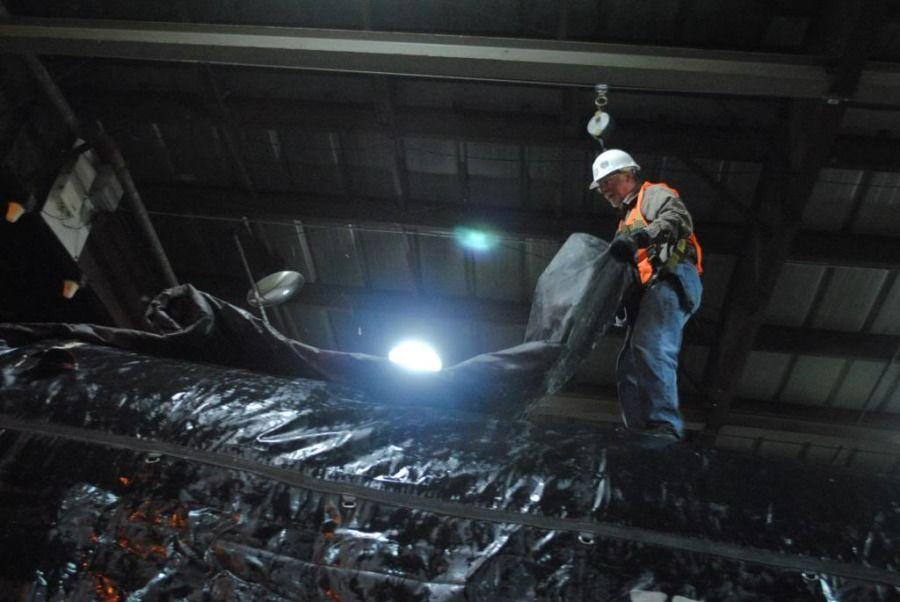 flatbedder strapping paper rolls bound for a Sheetrock plant in Bridgeport Alabama