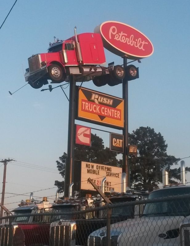Rush Truck Centers sign in Lufkin, TX with Peterbilt truck on top