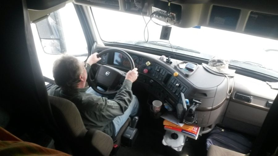 in-cab picture of truck driver behind the wheel