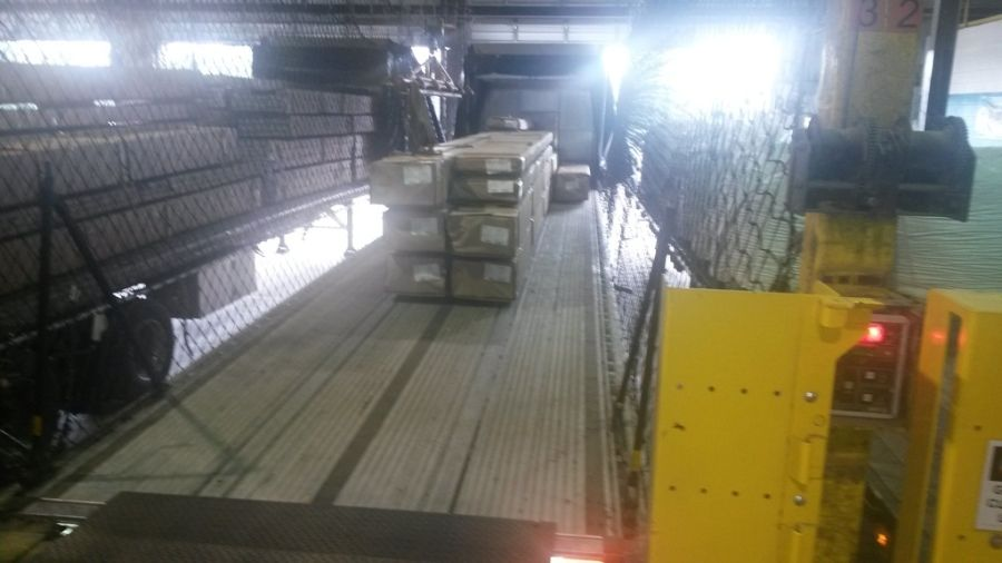 flatbed trailer backed into the dock at the SAPA aluminum plant in Delhi Louisiana