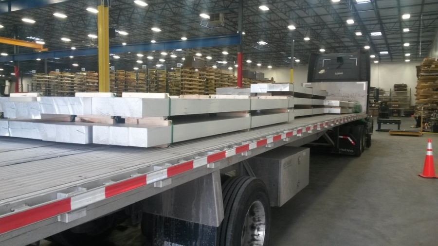 flatbed trailer inside being loaded with aluminum bars in Cressona PA going to Thyssen Krupp