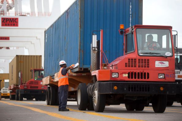 spotter-lines-up-a-truck-before-a-contai