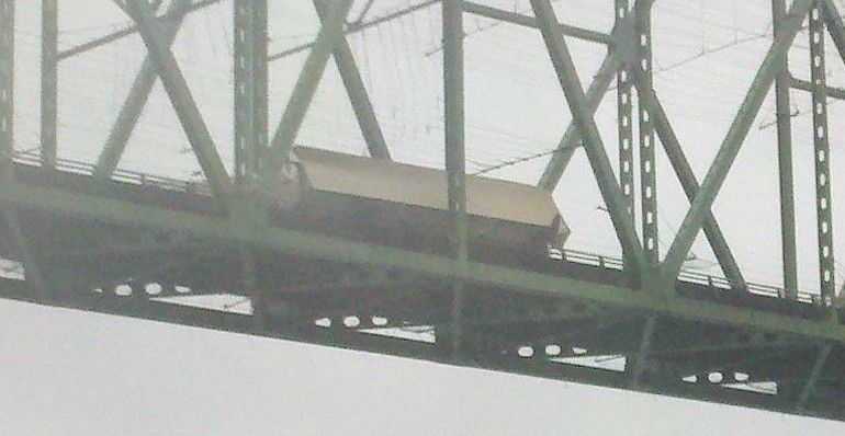 picture of a semi hanging off the The Astoria-Megler Bridge