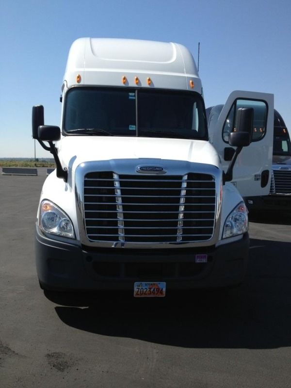 white central refrigerated freightliner truck