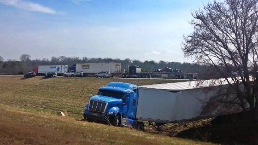 Blue Peterbuilt stuck in the median on I-75 north in Bradley County, TN after attempting to do a U-turn on the Interstate