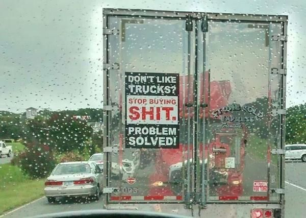 funny trucking sign on back of silver trailer don't like trucks stop buying sh*t