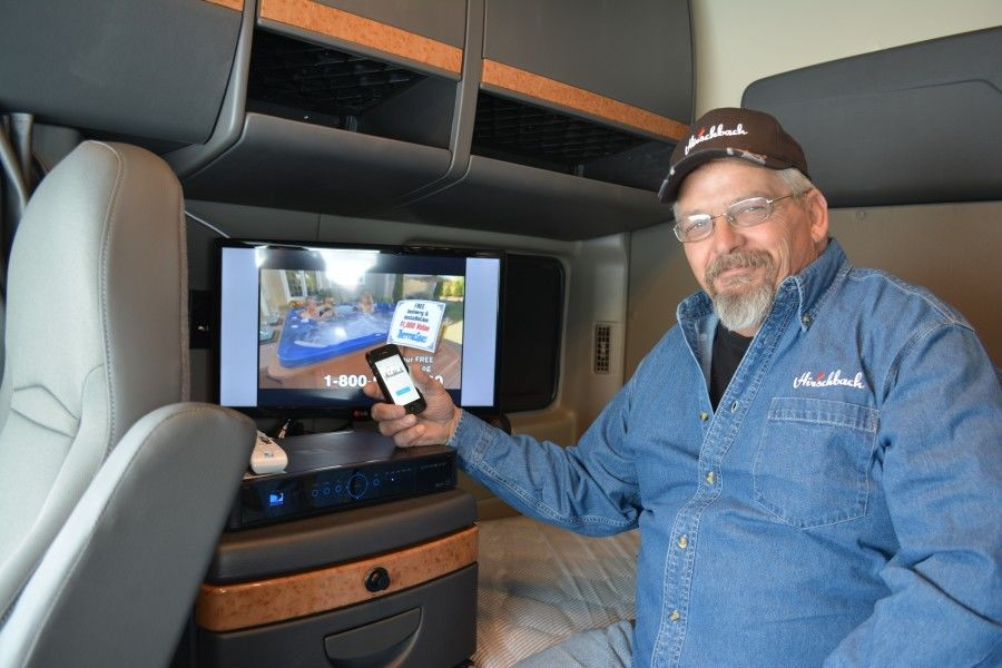 Hirschbach driver in his truck watching free DirectTV NFL Ticket on LCD TV