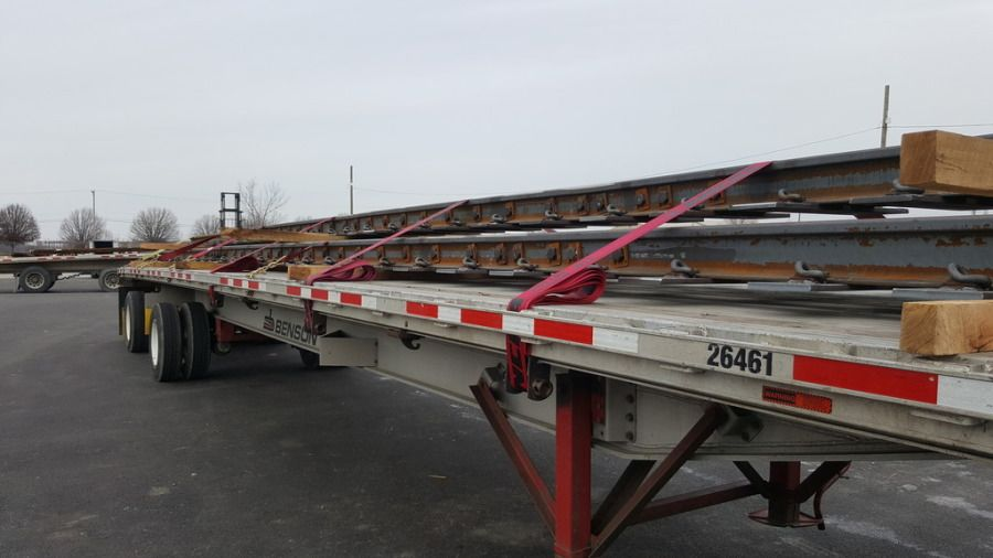 flatbed trailer loaded with railroad parts