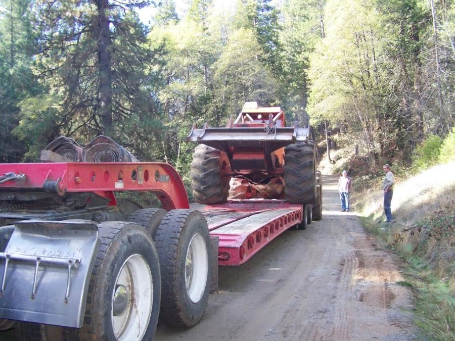 loading a skidsteer on to a flatbed