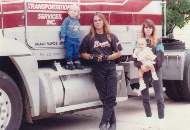 Brett Aquila truck driver standing in front of Gainey Transport truck in the early 1990's