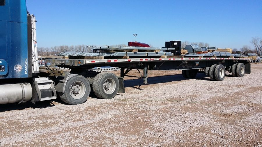 pieces of Verizon cell tower loaded on Melton flatbed trailer