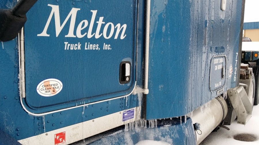 blue Melton truck parked in the snow and ice