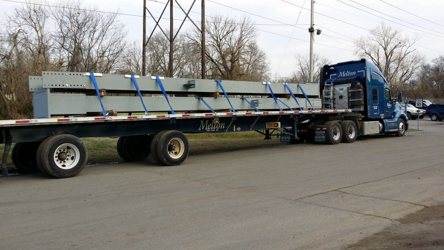 structural supports for Boeing plant loaded on Melton flatbed trailer