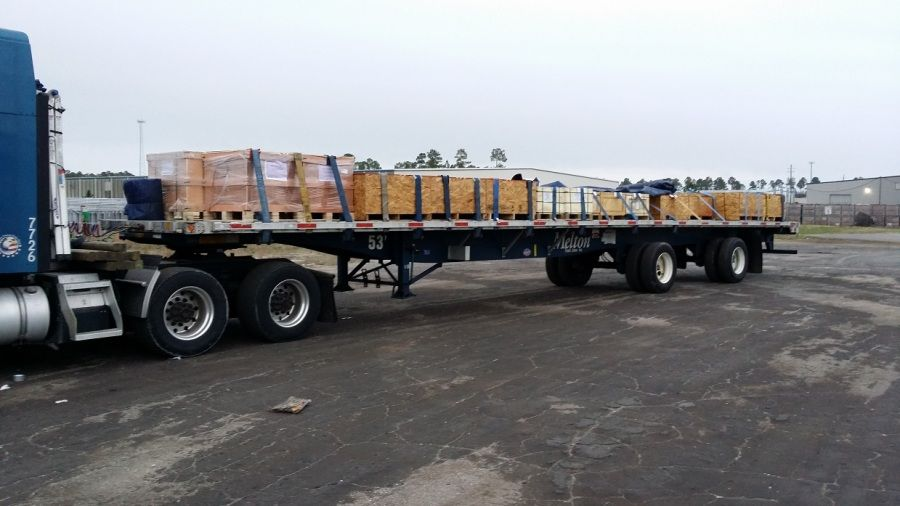 boxes loaded and strapped on Melton flatbed trailer