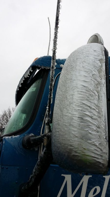Blue Melton Kenworth flatbed truck mirror and antenna iced over from Pennsylvania ice storm