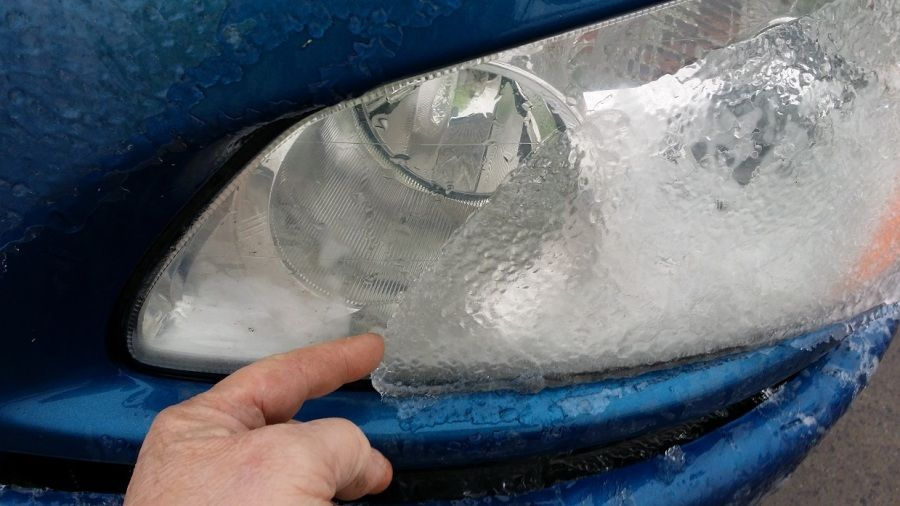 Blue Melton Kenworth flatbed truck headlights iced over from Pennsylvania ice storm