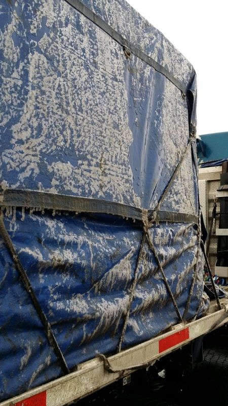 Blue Melton Kenworth flatbed  tarped and strapped trailer iced over from Pennsylvania ice storm