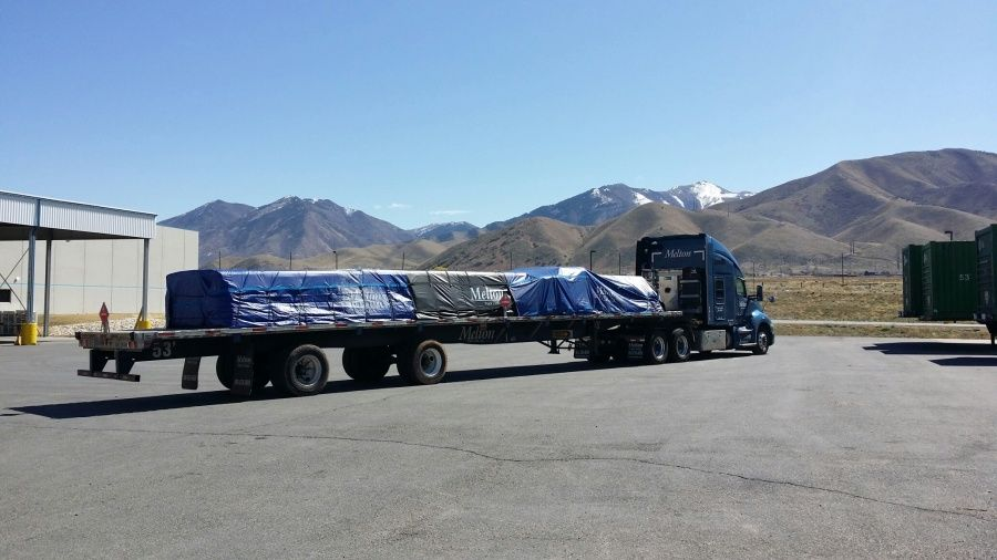Melton flatbed trailer tarped strapped and hazmat placarded