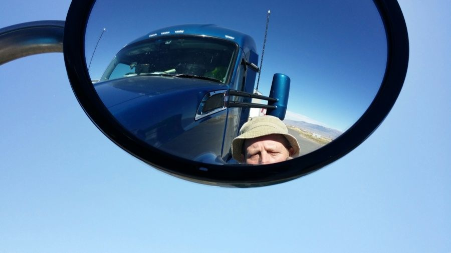 truck driver selfie in mirror like Wilson from Tool Time Home Improvement