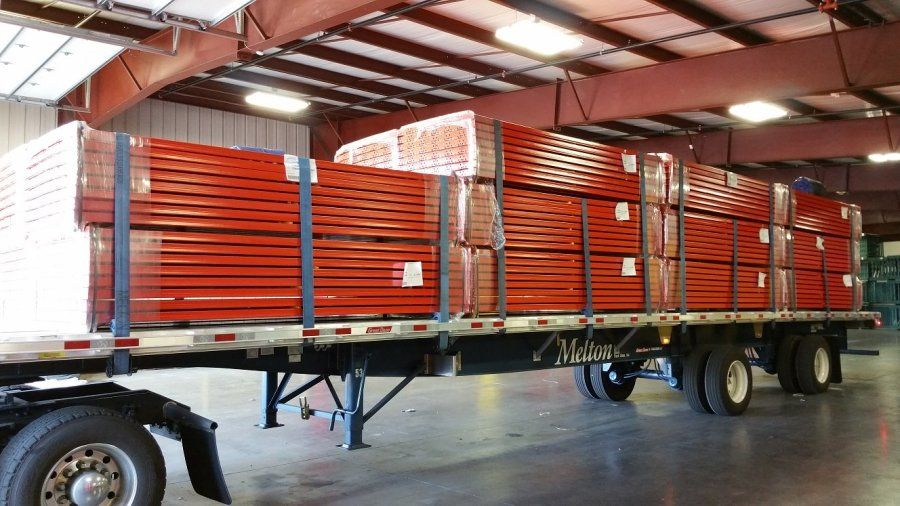 flatbed trailer in loading dock loaded with shelving for WalMart distribution center